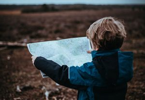 little boy reading a map